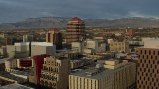DX0002_127_043 - 5.7K stock footage aerial video fly away from office high-rise, reveal federal building, Downtown Albuquerque, New Mexico