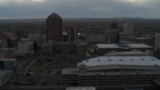 DX0002_128_005 - 5.7K stock footage aerial video orbit around office high-rise, hotel, convention center, Kiva Auditorium at sunset, Downtown Albuquerque, New Mexico