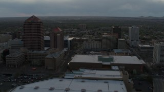 DX0002_128_006 - 5.7K stock footage aerial video orbit office high-rise, hotel, and the Kiva Auditorium at sunset, Downtown Albuquerque, New Mexico