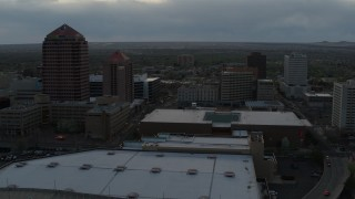 DX0002_128_007 - 5.7K stock footage aerial video orbit office high-rise, hotel, Kiva Auditorium at sunset, Downtown Albuquerque, New Mexico