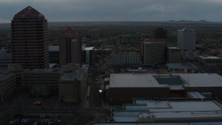 DX0002_128_009 - 5.7K stock footage aerial video of office high-rise, hotel, and Kiva Auditorium at sunset during descent, Downtown Albuquerque, New Mexico