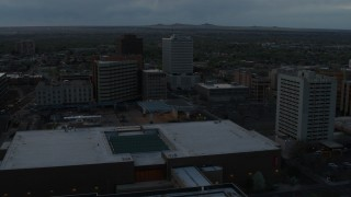 DX0002_128_013 - 5.7K stock footage aerial video flyby hotel, office buildings, Kiva Auditorium at sunset, Downtown Albuquerque, New Mexico