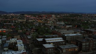 DX0002_128_014 - 5.7K stock footage aerial video of a hospital seen from downtown at twilight, Albuquerque, New Mexico