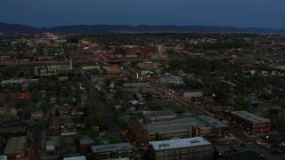 DX0002_128_015 - 5.7K stock footage aerial video of a view of a hospital from downtown at twilight, Albuquerque, New Mexico