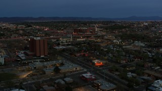 DX0002_128_016 - 5.7K stock footage aerial video orbit hospital and reveal a medical center at twilight, Albuquerque, New Mexico