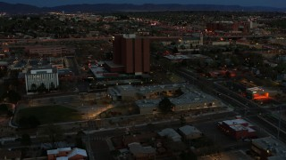 DX0002_128_017 - 5.7K stock footage aerial video orbit medical center at twilight, Albuquerque, New Mexico