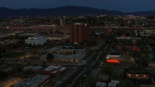 DX0002_128_018 - 5.7K stock footage aerial video orbit around medical center at twilight, then approach, Albuquerque, New Mexico