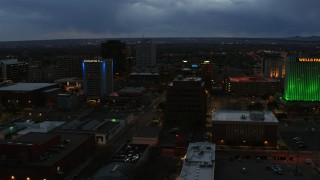 DX0002_128_020 - 5.7K stock footage aerial video orbit office buildings near hotel at twilight, Downtown Albuquerque, New Mexico