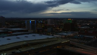 DX0002_128_022 - 5.7K stock footage aerial video fly over convention center to approach hotel and office buildings at twilight, Downtown Albuquerque, New Mexico