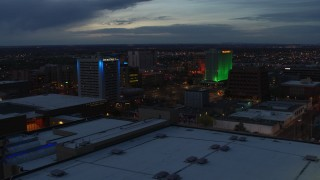 DX0002_128_024 - 5.7K stock footage aerial video approach and flyby hotel and office buildings at twilight, Downtown Albuquerque, New Mexico