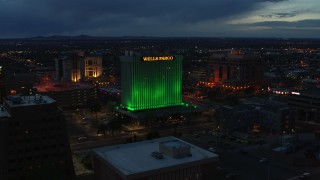 DX0002_128_025 - 5.7K stock footage aerial video of flying by the Wells Fargo Building at twilight, Downtown Albuquerque, New Mexico