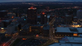 DX0002_128_029 - 5.7K stock footage aerial video orbit office high-rise and hotel at twilight, Downtown Albuquerque, New Mexico