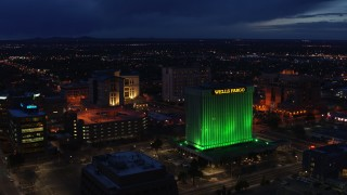 DX0002_128_038 - 5.7K stock footage aerial video approach and flyby office buildings and Wells Fargo Building at twilight, Downtown Albuquerque, New Mexico