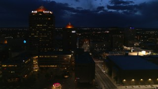 DX0002_128_041 - 5.7K stock footage aerial video flyby city street, high-rise office building and hotel at twilight, Downtown Albuquerque, New Mexico