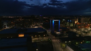 DX0002_128_042 - 5.7K stock footage aerial video flyby auditorium, hotel and reveal office building at twilight, Downtown Albuquerque, New Mexico