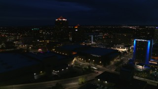 DX0002_128_045 - 5.7K stock footage aerial video wide orbit of office high-rise, hotel and auditorium at twilight, Downtown Albuquerque, New Mexico