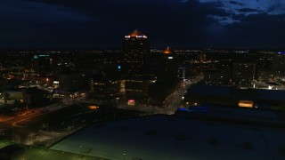 DX0002_128_046 - 5.7K stock footage aerial video of office high-rise, hotel and auditorium at twilight, Downtown Albuquerque, New Mexico