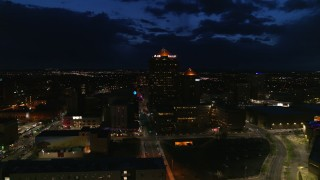 DX0002_128_047 - 5.7K stock footage aerial video orbit office high-rise and hotel at twilight, Downtown Albuquerque, New Mexico
