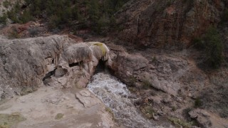 DX0002_129_007 - 5.7K stock footage aerial video approach and orbit river rapids flowing through a rock formation in the mountains in New Mexico