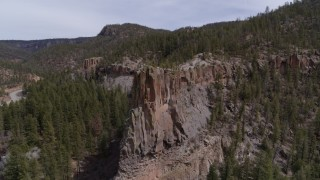 DX0002_129_012 - 5.7K stock footage aerial video of orbiting a rock formation jutting from a mountain in New Mexico