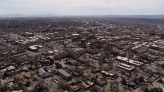 DX0002_129_022 - 5.7K stock footage aerial video of the downtown area and surrounding city of Santa Fe, New Mexico during descent