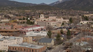 DX0002_129_036 - 5.7K stock footage aerial video orbiting of state government buildings in the city's downtown area, Santa Fe, New Mexico