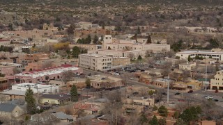 DX0002_129_037 - 5.7K stock footage aerial video reverse view of state government buildings in the city's downtown area, Santa Fe, New Mexico