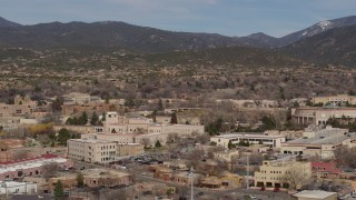 DX0002_129_038 - 5.7K stock footage aerial video of flying by Bataan Memorial Building in the city's downtown area, Santa Fe, New Mexico