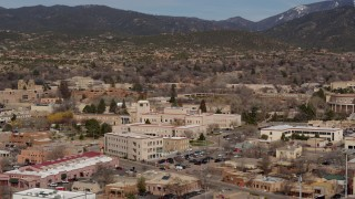 DX0002_129_041 - 5.7K stock footage aerial video fly away from Bataan Memorial Building near capitol building, Santa Fe, New Mexico
