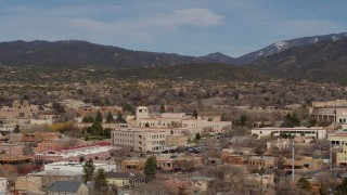 DX0002_129_044 - 5.7K stock footage aerial video of passing by Bataan Memorial Building near capitol building, Santa Fe, New Mexico