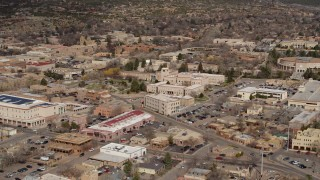 DX0002_130_003 - 5.7K stock footage aerial video ascend for view of Bataan Memorial Building near capitol, Santa Fe, New Mexico