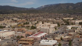 DX0002_130_005 - 5.7K stock footage aerial video approach Bataan Memorial Building near capitol, Santa Fe, New Mexico