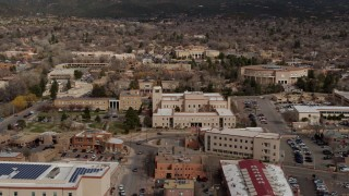 DX0002_130_008 - 5.7K stock footage aerial video fly away from Bataan Memorial Building and state capitol building, Santa Fe, New Mexico
