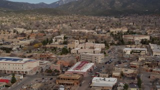 DX0002_130_009 - 5.7K stock footage aerial video descend and focus on Bataan Memorial Building near state capitol building, Santa Fe, New Mexico