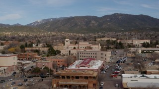 DX0002_130_010 - 5.7K stock footage aerial video orbit Bataan Memorial Building, state capitol in background, Santa Fe, New Mexico