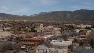 DX0002_130_011 - 5.7K stock footage aerial video an orbit of state government offices and shops, state capitol in background, Santa Fe, New Mexico