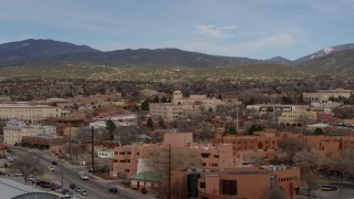 DX0002_130_013 - 5.7K stock footage aerial video flyby shops and downtown buildings, focus on Bataan Memorial Building in Santa Fe, New Mexico