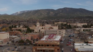 DX0002_130_014 - 5.7K stock footage aerial video circling Bataan Memorial Building near the state capitol in Santa Fe, New Mexico