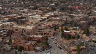 DX0002_130_029 - 5.7K stock footage aerial video of circling two hotels and a cathedral in Santa Fe, New Mexico