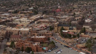 DX0002_130_030 - 5.7K stock footage aerial video of an orbit of two hotels and a cathedral in Santa Fe, New Mexico