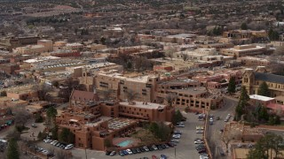 DX0002_130_033 - 5.7K stock footage aerial video flyby hotels to reveal a cathedral in Santa Fe, New Mexico