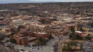 DX0002_130_038 - 5.7K stock footage aerial video approach and flyby downtown hotels in Santa Fe, New Mexico