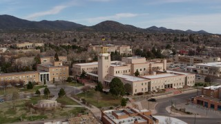 DX0002_131_001 - 5.7K stock footage aerial video of closely orbiting the Bataan Memorial Building in Santa Fe, New Mexico
