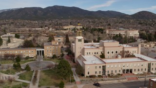 DX0002_131_002 - 5.7K stock footage aerial video of a close orbit of the Bataan Memorial Building in Santa Fe, New Mexico