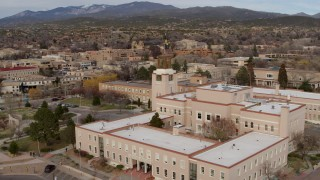 DX0002_131_004 - 5.7K stock footage aerial video of a reverse view of the Bataan Memorial Building in Santa Fe, New Mexico