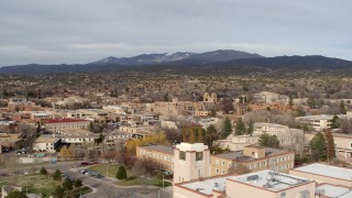 DX0002_131_013 - 5.7K stock footage aerial video wide view of downtown while flying by tower on Bataan Memorial Building, Santa Fe, New Mexico