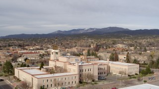 DX0002_131_015 - 5.7K stock footage aerial video of passing the Bataan Memorial Building for wide view of downtown, Santa Fe, New Mexico