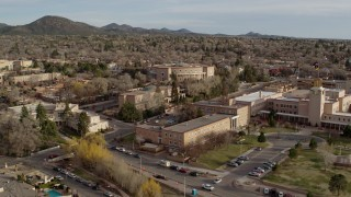 DX0002_131_041 - 5.7K stock footage aerial video orbit and fly away from state capitol, revealing Bataan Memorial Building, Santa Fe, New Mexico