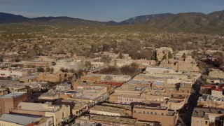DX0002_132_003 - 5.7K stock footage aerial video flyby and away from downtown buildings around Santa Fe Plaza, Santa Fe, New Mexico