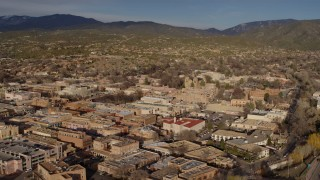 DX0002_132_004 - 5.7K stock footage aerial video flying past downtown buildings, Santa Fe, New Mexico